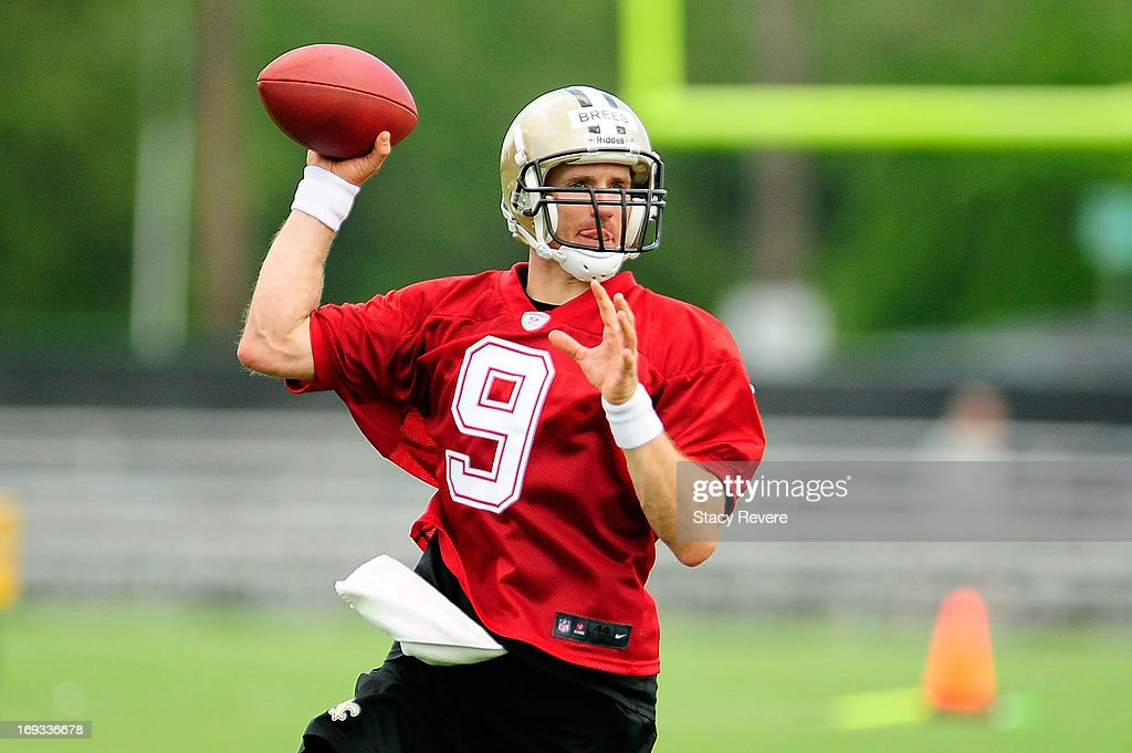 Drew Brees #9 of the New Orleans Saints prepares to throw a pass during OTA's, organized team activities, at the Saints training facility on May 23, 2013 in Metairie, Louisiana.