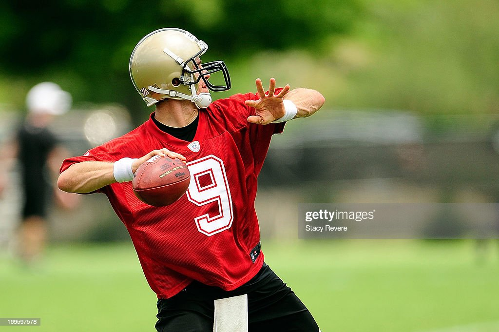 Drew Brees #9 of the New Orleans Saints prepares to throw a pass during OTA's (organized team activities) at the Saints training facility on May 23, 2013 in Metairie, Louisiana.