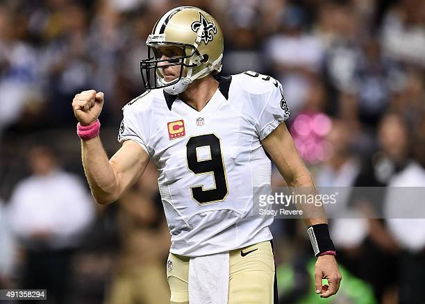 Drew Brees of the New Orleans Saints reacts after the Saints score a touchdown during the fourth quarter against the Dallas Cowboys at MercedesBenz...