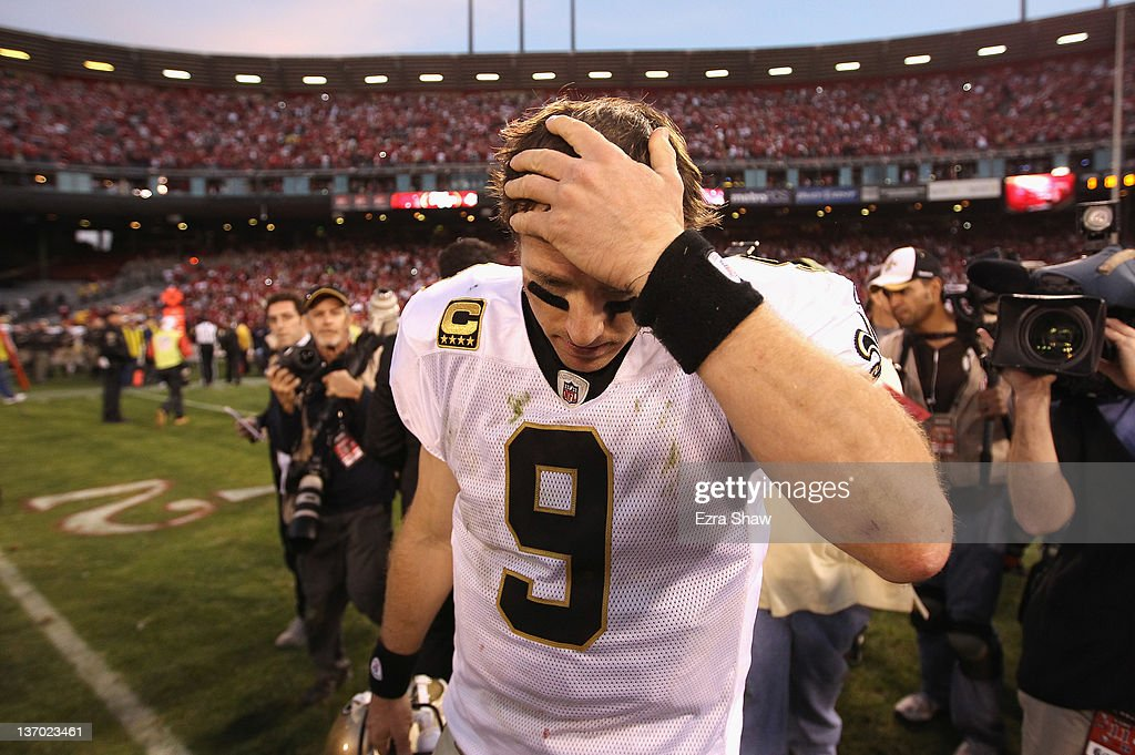 <a gi-track='captionPersonalityLinkClicked' href=/galleries/search?phrase=Drew+Brees&family=editorial&specificpeople=202562 ng-click='$event.stopPropagation()'>Drew Brees</a> #9 of the New Orleans Saints reacts after they lost their game against the the San Francisco 49ers in the NFC Divisional playoff game at Candlestick Park on January 14, 2012 in San Francisco, California.