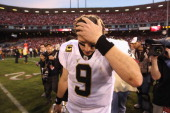 Drew Brees of the New Orleans Saints reacts after they lost their game against the the San Francisco 49ers in the NFC Divisional playoff game at...