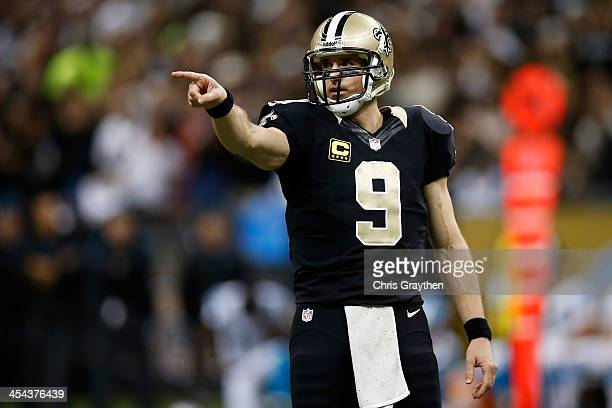 Drew Brees of the New Orleans Saints reacts after throwing a pass against the Carolina Panthers at MercedesBenz Superdome on December 8 2013 in New...