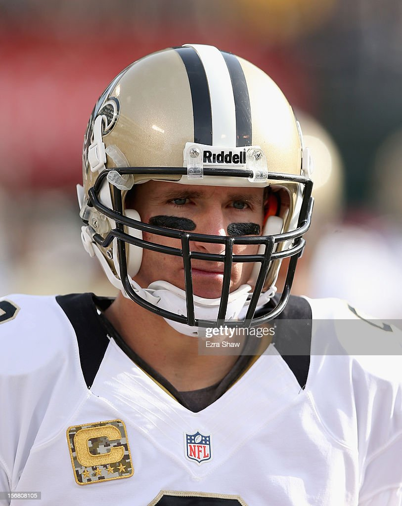 Drew Brees #9 of the New Orleans Saints stands on the sidelines during their game against the Oakland Raiders at O.co Coliseum on November 18, 2012 in Oakland, California.