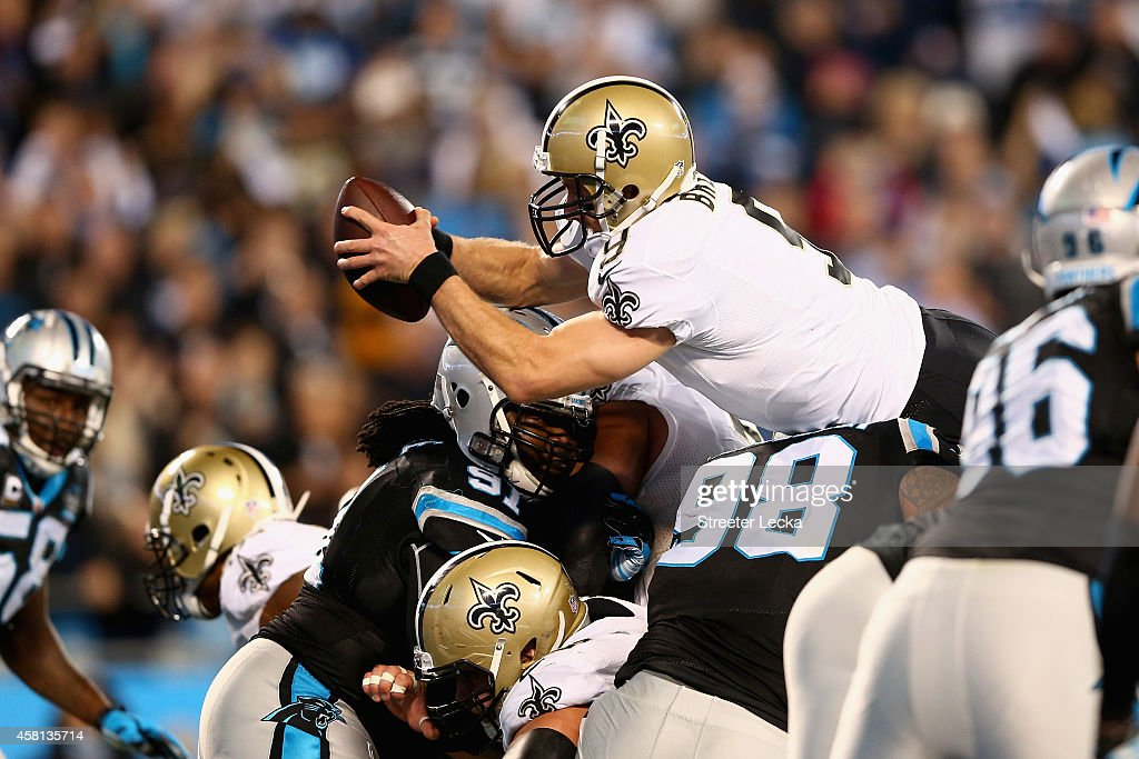 Drew Brees of the New Orleans Saints stretches across the goal line for a touchdown against the Carolina Panthers during their game at Bank of...