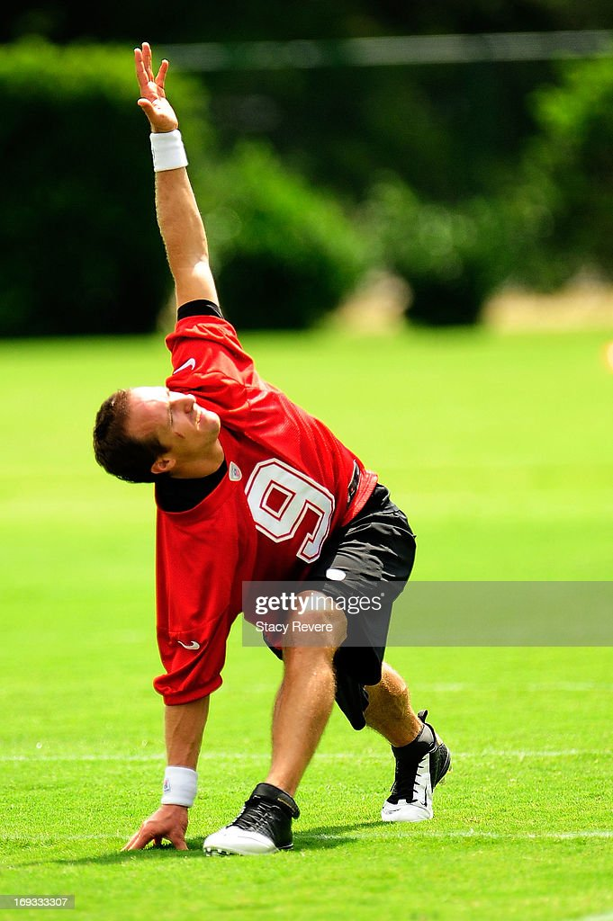 <a gi-track='captionPersonalityLinkClicked' href=/galleries/search?phrase=Drew+Brees&family=editorial&specificpeople=202562 ng-click='$event.stopPropagation()'>Drew Brees</a> #9 of the New Orleans Saints stretches during OTA's, organized team activities, at the Saints training facility on May 23, 2013 in Metairie, Louisiana.