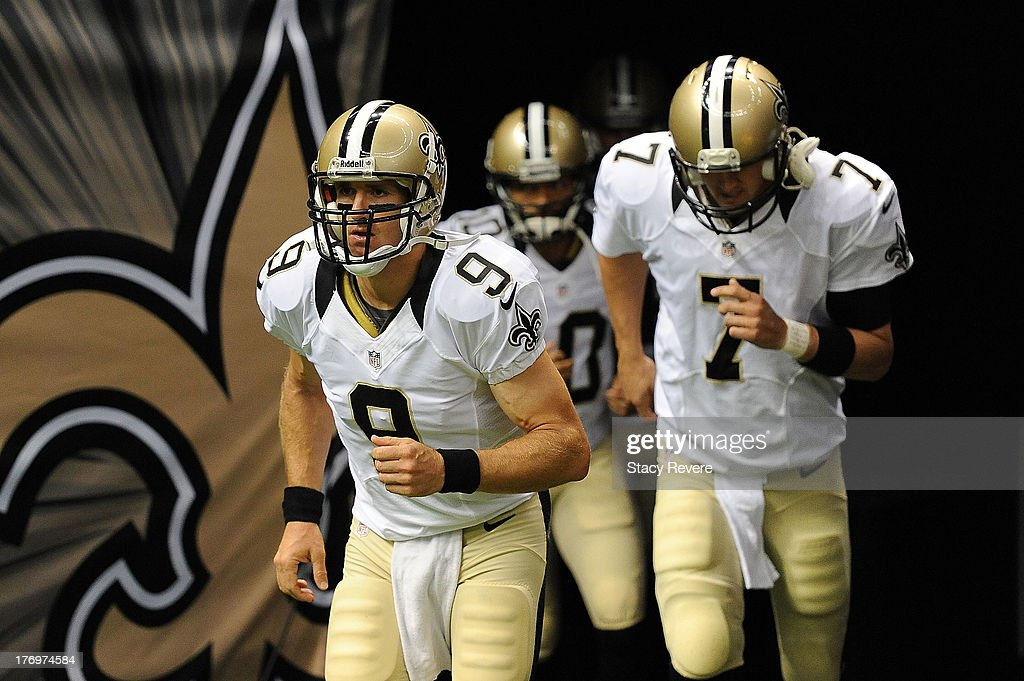 Drew Brees #9 of the New Orleans Saints takes the field for warm-ups prior to a preseason game against the Oakland Raiders at the Mercedes-Benz Superdome on August 16, 2013 in New Orleans, Louisiana. The Saints won 28-20.