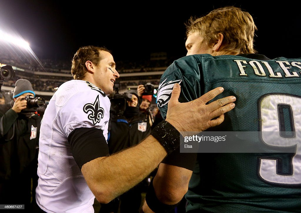 Drew Brees #9 of the New Orleans Saints talks with Nick Foles #9 of the Philadelphia Eagles after their NFC Wild Card Playoff game at Lincoln Financial Field on January 4, 2014 in Philadelphia, Pennsylvania. The New Orleans Saints defeated the Philadelphia Eagles 26 - 24.