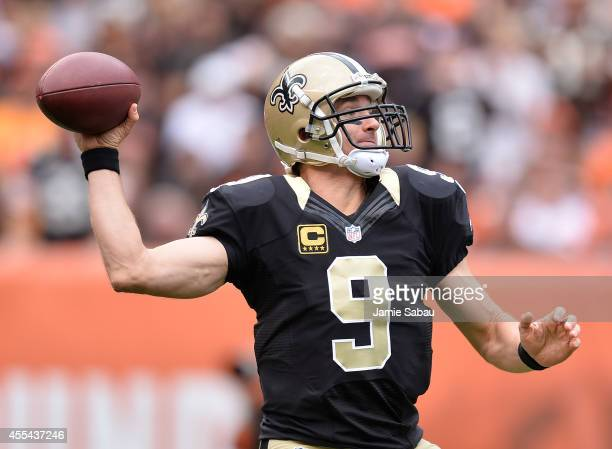 Drew Brees of the New Orleans Saints throws a first quarter pass against the Cleveland Browns at FirstEnergy Stadium on September 14 2014 in...