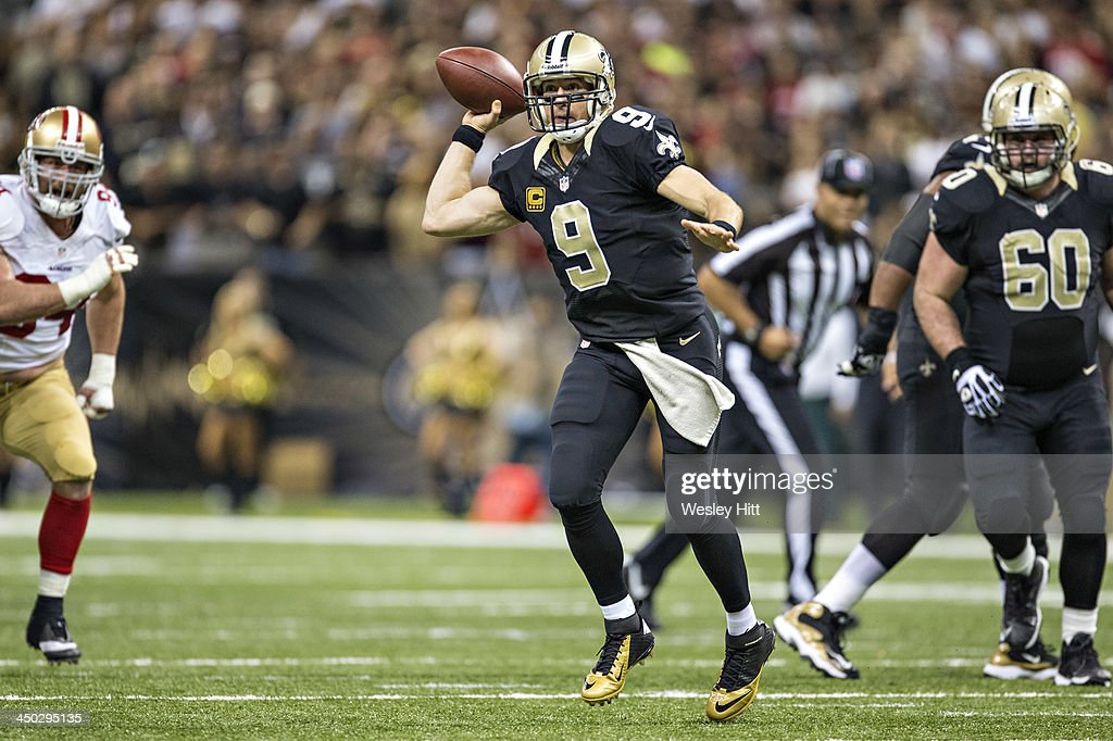 <a gi-track='captionPersonalityLinkClicked' href=/galleries/search?phrase=Drew+Brees&family=editorial&specificpeople=202562 ng-click='$event.stopPropagation()'>Drew Brees</a> #9 of the New Orleans Saints throws a pass against the San Francisco 49ers at Mercedes-Benz Superdome on November 17, 2013 in New Orleans, Louisiana. The Saints defeated the 49ers 23-20.