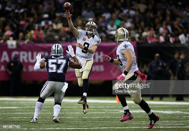 Drew Brees of the New Orleans Saints throws a pass over Damien Wilson of the Dallas Cowboys at MercedesBenz Superdome on October 4 2015 in New...