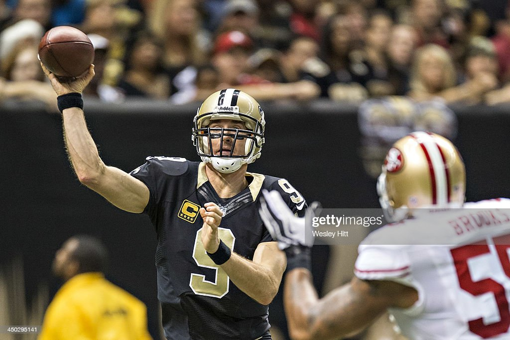 <a gi-track='captionPersonalityLinkClicked' href=/galleries/search?phrase=Drew+Brees&family=editorial&specificpeople=202562 ng-click='$event.stopPropagation()'>Drew Brees</a> #9 of the New Orleans Saints throws a pass the San Francisco 49ers at Mercedes-Benz Superdome on November 17, 2013 in New Orleans, Louisiana. The Saints defeated the 49ers 23-20.