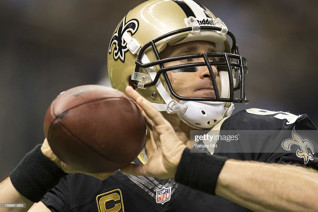 Drew Brees #9 of the New Orleans Saints warms up before a game against the Carolina Panthers at Mercedes-Benz Superdome on December 30, 2012 in New Orleans, Louisiana. The Panthers defeated the Saints 44-38.