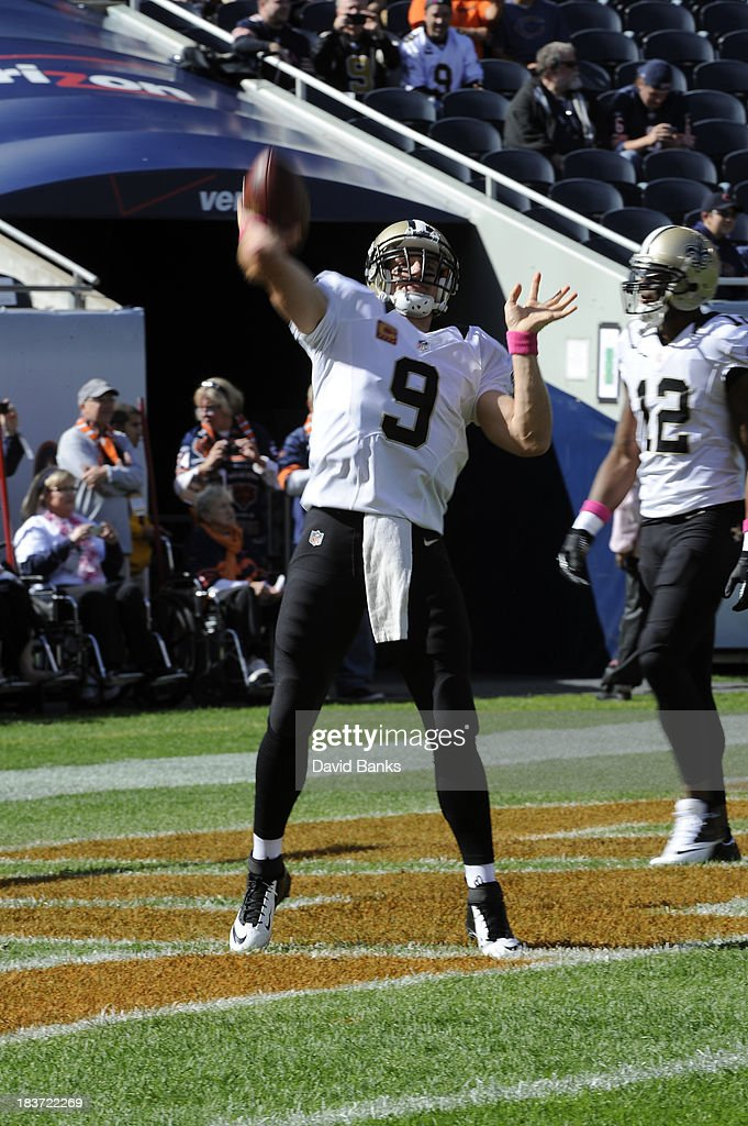 <a gi-track='captionPersonalityLinkClicked' href=/galleries/search?phrase=Drew+Brees&family=editorial&specificpeople=202562 ng-click='$event.stopPropagation()'>Drew Brees</a> #9 of the New Orleans Saints warms up before the game against the Chicago Bears on October 6, 2013 at Soldier Field in Chicago, Illinois.