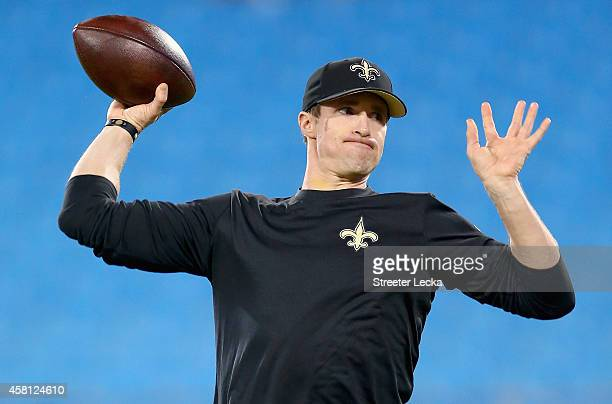 Drew Brees of the New Orleans Saints warms up before their game against the Carolina Panthers at Bank of America Stadium on October 30 2014 in...