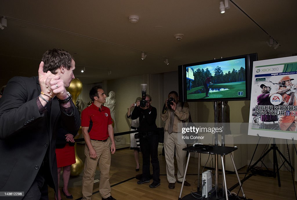 <a gi-track='captionPersonalityLinkClicked' href=/galleries/search?phrase=Drew+Brees&family=editorial&specificpeople=202562 ng-click='$event.stopPropagation()'>Drew Brees</a> plays Tiger Wood PGA Tour 13 on Xbox during the Active Play Video Game Demonstration at Smithsonian American Art Museum & National Portrait Gallery on April 30, 2012 in Washington, DC.