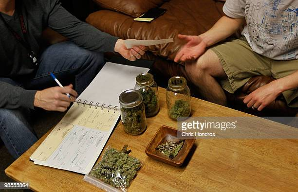 Drew Brown a vice president at Abundant Healing store hands over a check to one of his marijuana suppliers April 19 2010 in Fort Collins Colorado...
