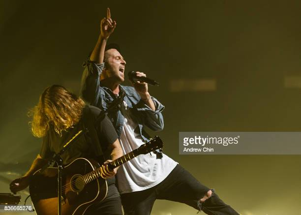 Drew Brown and Ryan Tedder of OneRepublic perform on stage at Rogers Arena on August 21 2017 in Vancouver Canada