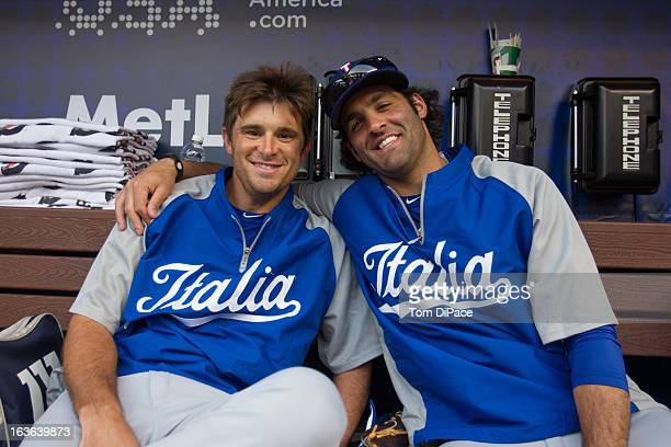 Drew Butera and Michael Costanzo of Team Italy pose for a photo in the dugout before Pool 2 Game 3 against Puerto Rico in the second round of the...