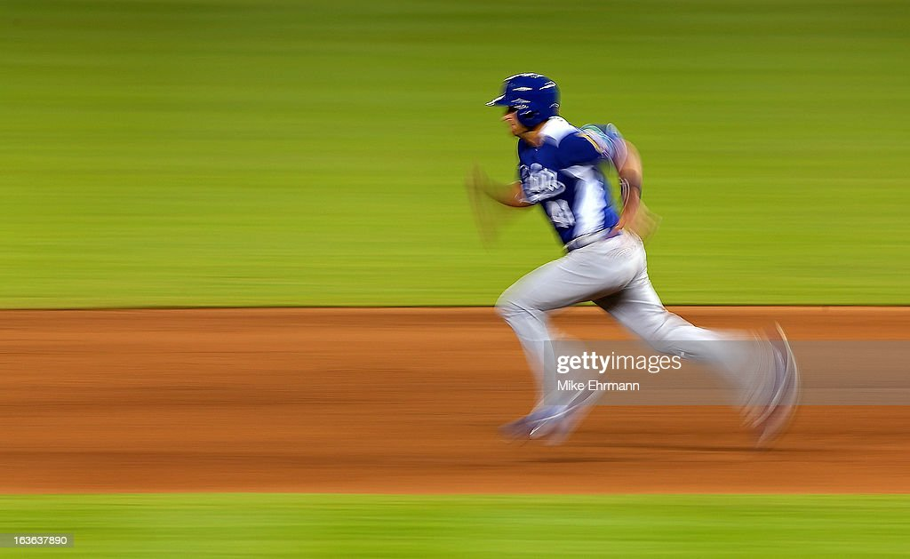 <a gi-track='captionPersonalityLinkClicked' href=/galleries/search?phrase=Drew+Butera&family=editorial&specificpeople=4175498 ng-click='$event.stopPropagation()'>Drew Butera</a> #41 of Italy runs the bases on during a World Baseball Classic second round game against Puerto Rico at Marlins Park on March 13, 2013 in Miami, Florida.