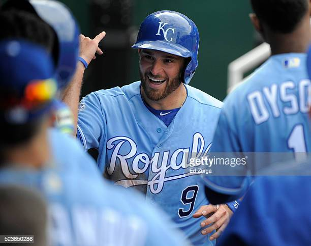 Drew Butera of the Kansas City Royals celebrates with teammates after scoring on a Mike Moustakas single in the seventh inning at Kauffman Stadium on...