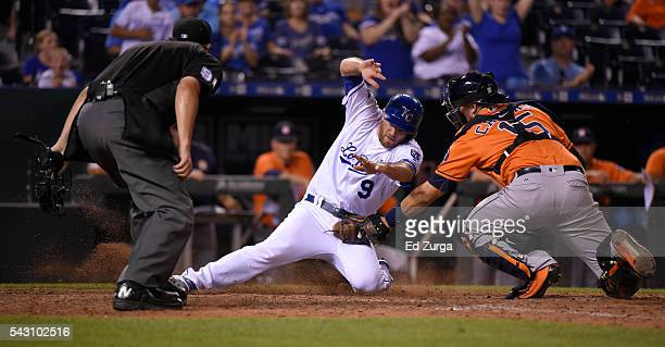 Drew Butera of the Kansas City Royals is tagged out at home by Jason Castro of the Houston Astros as plate umpire Mark Ripperger waits to make the...