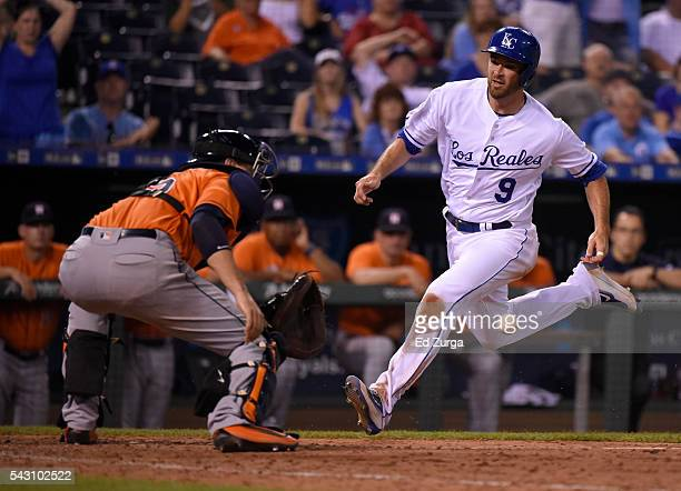Drew Butera of the Kansas City Royals runs home as he tries to score against Jason Castro of the Houston Astros in the ninth inning at Kauffman...