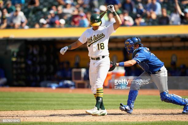 Drew Butera of the Kansas City Royals tags out Chad Pinder of the Oakland Athletics for a strike out for the final out of their game at Oakland...