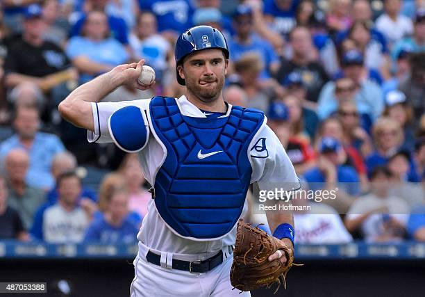 Drew Butera of the Kansas City Royals throws out Melky Cabrera of the Chicago White Sox at first base during the first inning of a game at Kauffman...