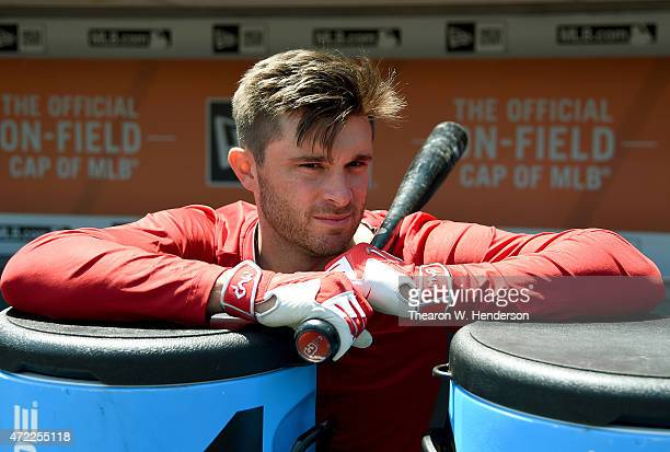Drew Butera of the Los Angeles Angels of Anaheim is seen in the dugout holding onto his bat prior to the game against the San Francisco Giants at ATT...