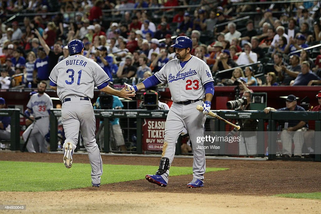 <a gi-track='captionPersonalityLinkClicked' href=/galleries/search?phrase=Drew+Butera&family=editorial&specificpeople=4175498 ng-click='$event.stopPropagation()'>Drew Butera</a> #31 of the Los Angeles Dodgers is congratulated after scoring by Adrian Gonzalez #23 in the sixth inning against the Arizona Diamondbacks at Chase Field on April 12, 2014 in Phoenix, Arizona.