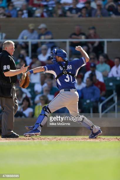 Drew Butera of the Los Angeles Dodgers makes the throw down to second base before the start of the inning against the Arizona Diamondbacks at Salt...