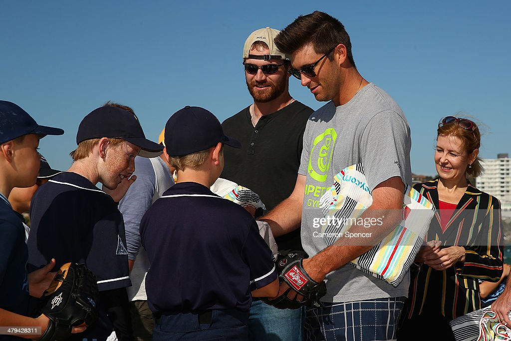 Drew Butera of the Los Angeles Dodgers meets players from Illawong Little League during a Los Angeles Dodgers players visit at Bondi Beach on March 19, 2014 in Sydney, Australia.