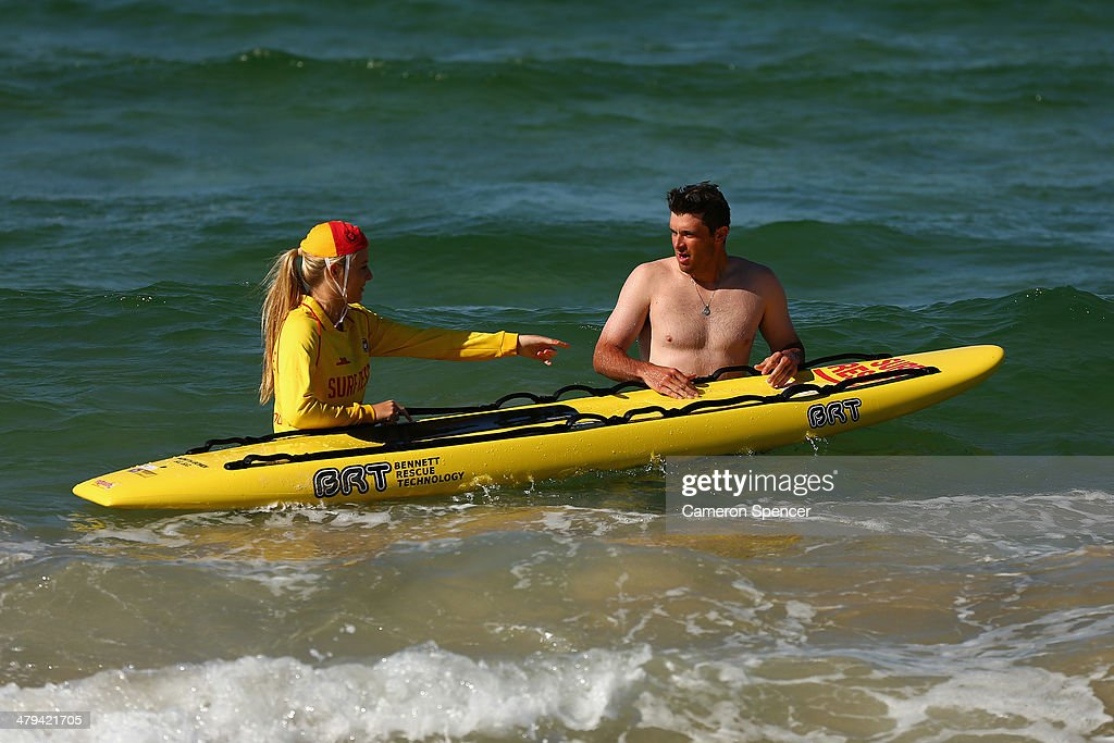 Drew Butera of the Los Angeles Dodgers swims with lifesaver Sophie Thomson during a Los Angeles Dodgers players visit at Bondi Beach on March 19, 2014 in Sydney, Australia.