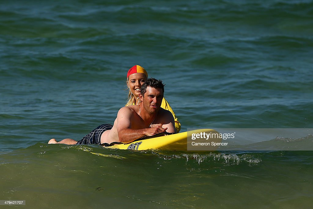 <a gi-track='captionPersonalityLinkClicked' href=/galleries/search?phrase=Drew+Butera&family=editorial&specificpeople=4175498 ng-click='$event.stopPropagation()'>Drew Butera</a> of the Los Angeles Dodgers swims with lifesaver Sophie Thomson during a Los Angeles Dodgers players visit at Bondi Beach on March 19, 2014 in Sydney, Australia.