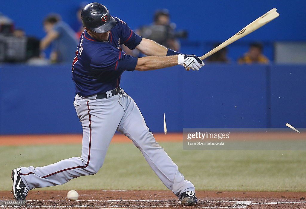 Drew Butera #41 of the Minnesota Twins splinters his bat in the third inning on a foul tip during MLB game action against the Toronto Blue Jays on October 3, 2012 at Rogers Centre in Toronto, Ontario, Canada.
