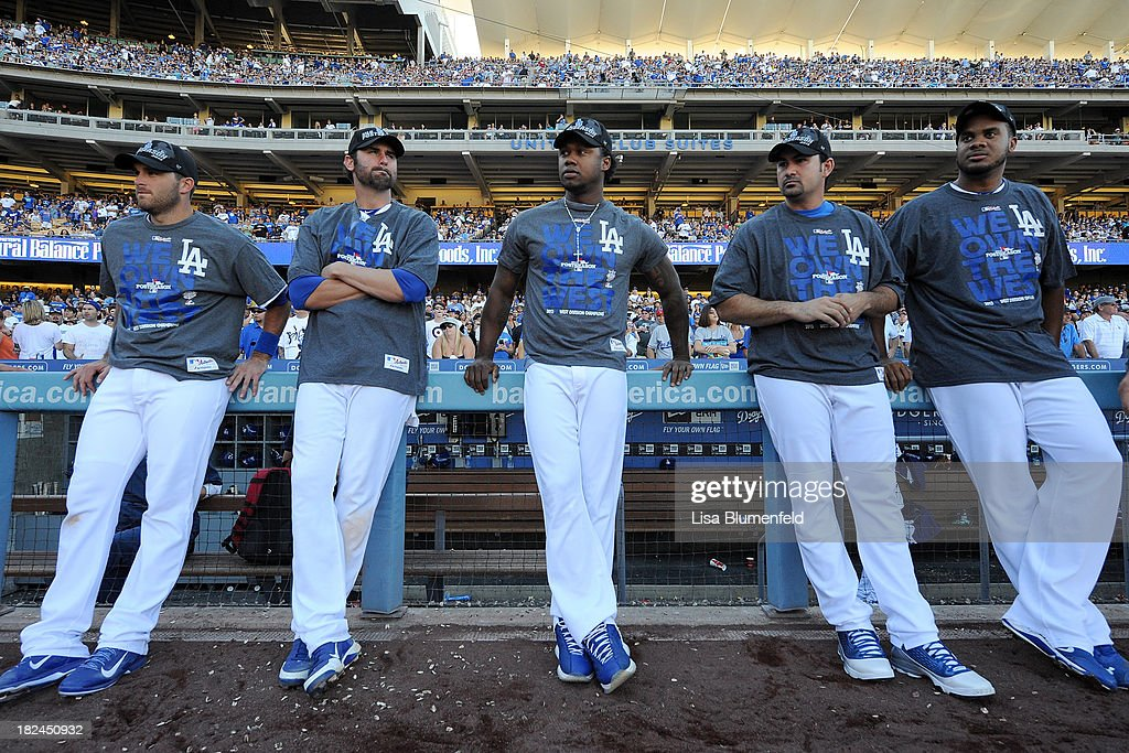 <a gi-track='captionPersonalityLinkClicked' href=/galleries/search?phrase=Drew+Butera&family=editorial&specificpeople=4175498 ng-click='$event.stopPropagation()'>Drew Butera</a> #31, Scott Van Slyke #33, <a gi-track='captionPersonalityLinkClicked' href=/galleries/search?phrase=Hanley+Ramirez&family=editorial&specificpeople=538406 ng-click='$event.stopPropagation()'>Hanley Ramirez</a> #13, Adrian Gonzalez #23 and <a gi-track='captionPersonalityLinkClicked' href=/galleries/search?phrase=Kenley+Jansen&family=editorial&specificpeople=5751411 ng-click='$event.stopPropagation()'>Kenley Jansen</a> #74 of the Los Angeles Dodgers stand along the dugout after the game against the Colorado Rockies at Dodger Stadium on September 29, 2013 in Los Angeles, California.
