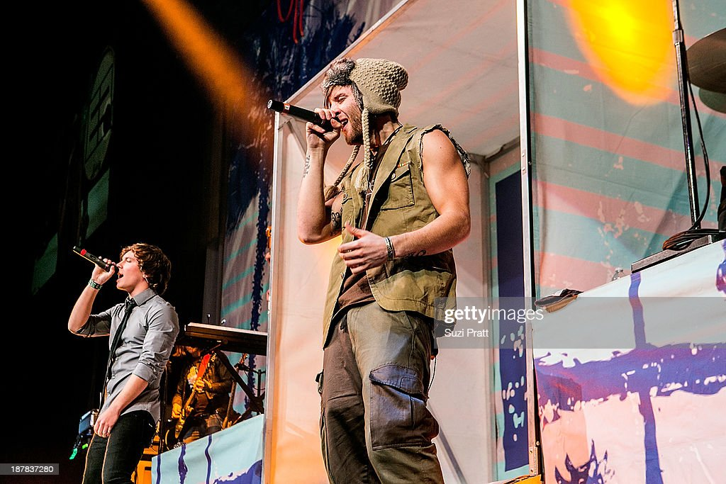 Drew Chadwick and Keaton Stromberg of Emblem3 performs live at Key Arena on November 12, 2013 in Seattle, Washington.