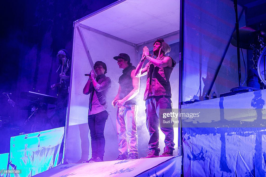 Drew Chadwick, Keaton Stromberg, and Wesley Stromberg of Emblem3 performs live at Key Arena on November 12, 2013 in Seattle, Washington.