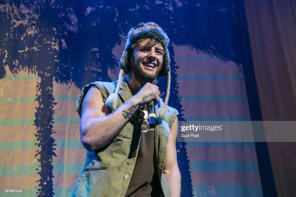 <a gi-track='captionPersonalityLinkClicked' href=/galleries/search?phrase=Drew+Chadwick&family=editorial&specificpeople=9720340 ng-click='$event.stopPropagation()'>Drew Chadwick</a> of Emblem3 performs live at Key Arena on November 12, 2013 in Seattle, Washington.