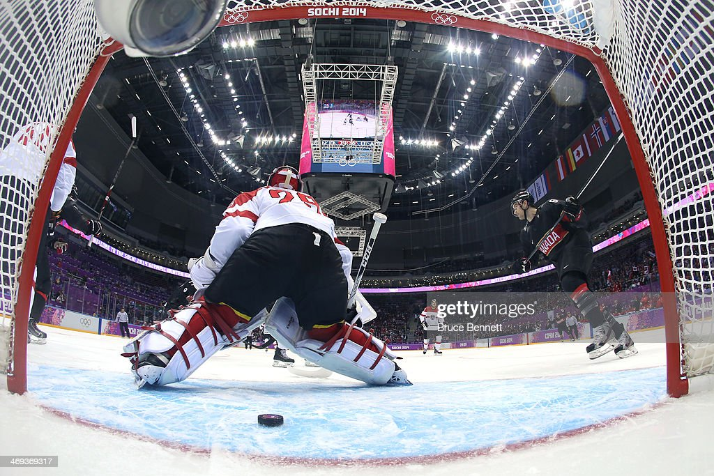 Drew Doughty (not pictured) #8 of Canada scoring a goal in the first period against <a gi-track='captionPersonalityLinkClicked' href=/galleries/search?phrase=Bernhard+Starkbaum&family=editorial&specificpeople=7542337 ng-click='$event.stopPropagation()'>Bernhard Starkbaum</a> #29 of Austria during the Men's Ice Hockey Preliminary Round Group B game on day seven of the Sochi 2014 Winter Olympics at Bolshoy Ice Dome on February 14, 2014 in Sochi, Russia.