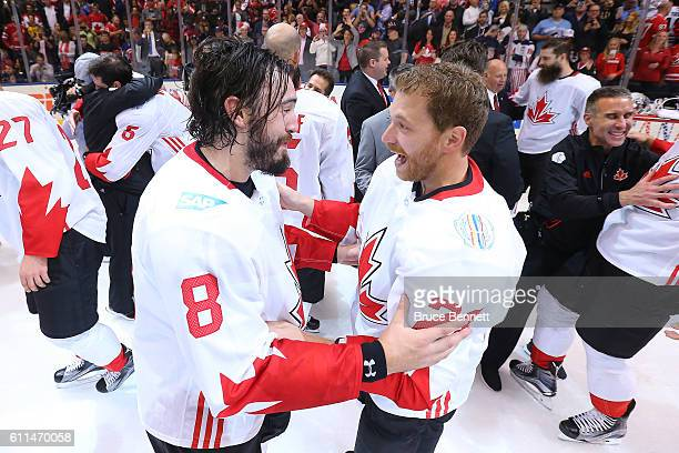 Drew Doughty and Corey Perry of Team Canada celebrate their win over Team Europe during Game Two of the World Cup of Hockey final series at the Air...