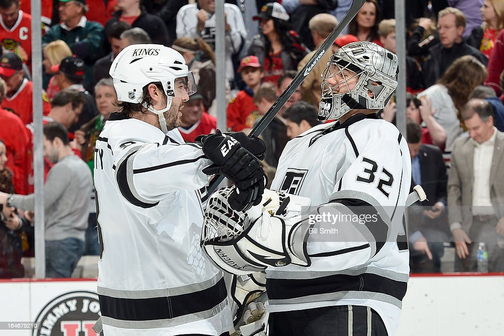 Drew Doughty #8 and goalie Jonathan Quick #32 of the Los Angeles Kings celebrate after the Kings defeated the Chicago Blackhawks 5 - 4 during the NHL game on March 25, 2013 at the United Center in Chicago, Illinois.