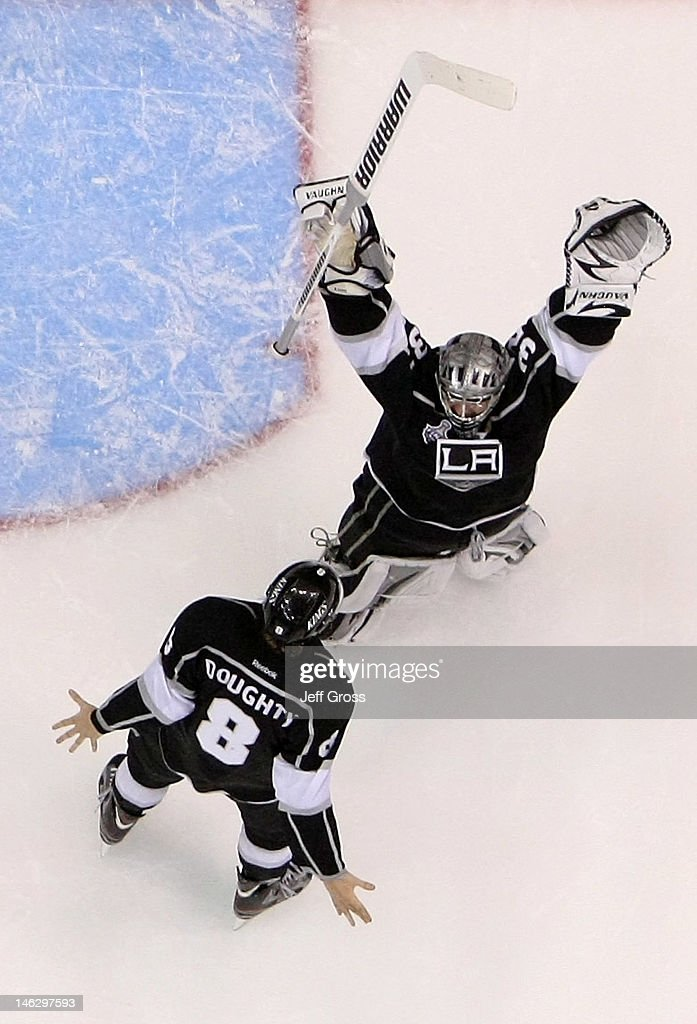 Drew Doughty #8 and goaltender Jonathan Quick #32 of the Los Angeles Kings celebrate the Kings 6-1 victory as they win the Stanley Cup final series 4-2 after Game Six of the 2012 Stanley Cup Final at Staples Center on June 11, 2012 in Los Angeles, California.