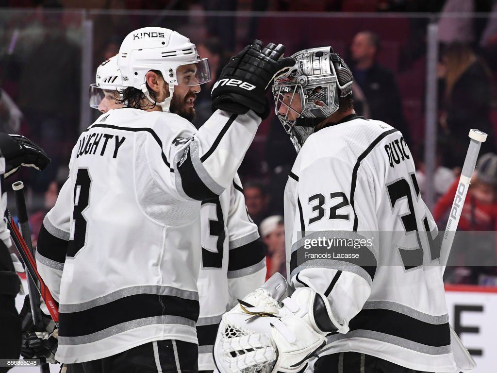 Drew Doughty #8 and Jonathan Quick #32 of the Los Angeles Kings celebrate the win over the Montreal Canadiens in the NHL game at the Bell Centre on October 26, 2017 in Montreal, Quebec, Canada.