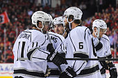 Drew Doughty and Justin Williams of the Los Angeles Kings confer between play against the Calgary Flames during an NHL game at Scotiabank Saddledome...