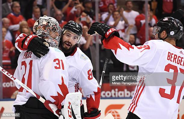 Drew Doughty and Patrice Bergeron celebrate with Carey Price of Team Canada after a 42 win over Team USA during the World Cup of Hockey 2016 at Air...