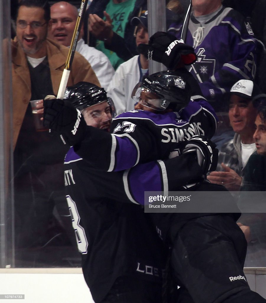 Drew Doughty #8 hugs Wayne Simmonds #17 of the Los Angeles Kings following Simmonds goal at 15:18 of the first period against the Toronto Maple Leafs at the Staples Center on January 10, 2011 in Los Angeles, California.