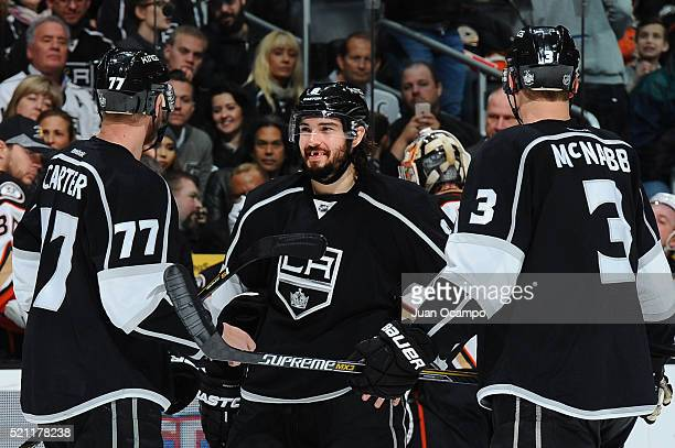 Drew Doughty Jeff Carter and Brayden McNabb of the Los Angeles Kings talk before resuming play during the game against the Anaheim Ducks on April 7...