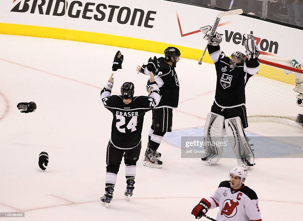 <a gi-track='captionPersonalityLinkClicked' href=/galleries/search?phrase=Drew+Doughty&family=editorial&specificpeople=2085761 ng-click='$event.stopPropagation()'>Drew Doughty</a> #8, <a gi-track='captionPersonalityLinkClicked' href=/galleries/search?phrase=Jonathan+Quick&family=editorial&specificpeople=2271852 ng-click='$event.stopPropagation()'>Jonathan Quick</a> #32 and <a gi-track='captionPersonalityLinkClicked' href=/galleries/search?phrase=Colin+Fraser&family=editorial&specificpeople=2225768 ng-click='$event.stopPropagation()'>Colin Fraser</a> #24 of the Los Angeles Kings celebrate the Kings 6-1 victory as <a gi-track='captionPersonalityLinkClicked' href=/galleries/search?phrase=Zach+Parise&family=editorial&specificpeople=213606 ng-click='$event.stopPropagation()'>Zach Parise</a> #9 of the New Jersey Devils looks on after the Kings win the Stanley Cup final series 4-2 after Game Six of the 2012 Stanley Cup Final at Staples Center on June 11, 2012 in Los Angeles, California.
