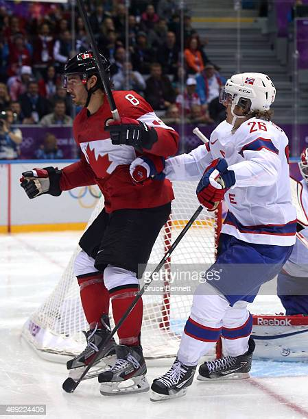 Drew Doughty of Canada and Kristian Forsberg of Norway collide in front of the net during the Men's Ice Hockey Preliminary Round Group B game on day...